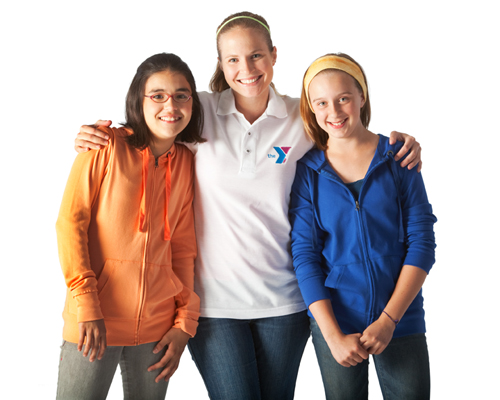 YMCA staff member standing with young girls