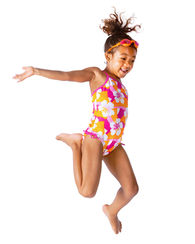 Young girl in bathing suit jumping