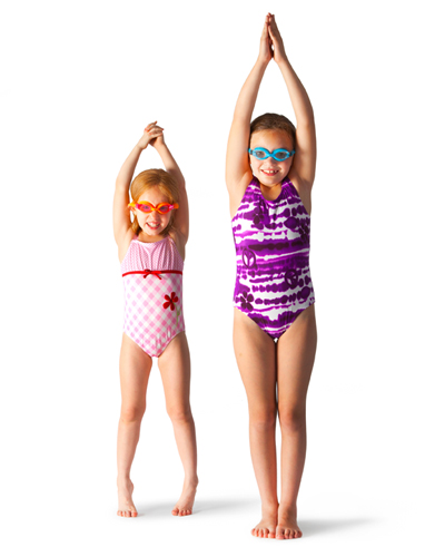 Young girls practice dive